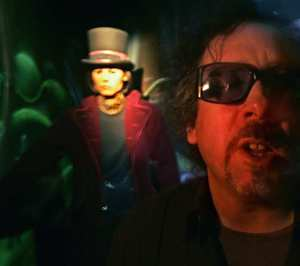 Tim Burton on his Alice in Wonderland set with an unnamed actor.